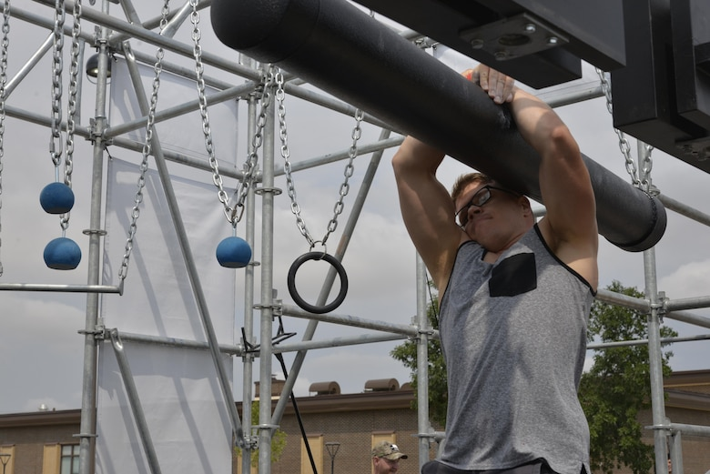 Airman 1st Class Bradley Borytsky, a mental health technician assigned to the 28th Medical Operations Squadron, tackles the third obstacle of the Alpha Warrior Battle Rig at Ellsworth Air Force Base, S.D. on Aug. 5, 2017. Borytsky placed number three out of 11 male competitors, the top male and female from their regions will go on to compete at Joint Base San Antonio, Texas. (U.S. Air Force photo by Airman 1st Class Michella T. Stowers)