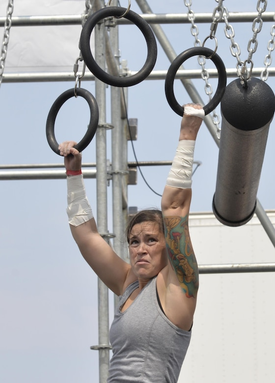 Staff Sgt. Amanda Hood, non-commissioned officer in charge of admin support assigned to Ellsworth's Office of Special Investigations, pushes herself to complete the Alpha Warrior Battle Rig course, at Ellsworth Air Force Base, S.D. on Aug. 5, 2017.  The course required immense physical strength in order to be completed. The Battle Rig consisted of five strength testing obstacles, requiring participants to swing, climb and lift their way to the finish. (U.S. Air Force photo by Airman 1st Class Michella T. Stowers)