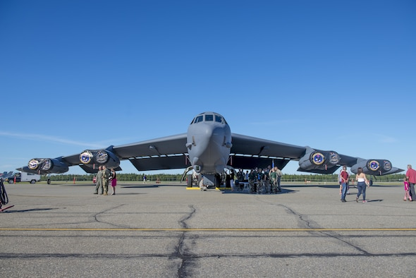 Families from around the Eielson community gather around a B-52 Strafofortress bomber aircraft assigned to the 2nd Bomber Wing, Barksdale Air Force Base (AFB), La., at the Eielson AFB, Alaska, Open House, August 5, 2017. The Event featured U.S. Air Force, Navy, Army and Royal Canadian Air Force assets. (U.S. Air Force photo by Airman 1st Class Isaac Johnson)