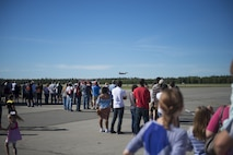People from across the Fairbanks North Star Borough gather to watch an F-16 fighting Falcon aircraft assigned to the 18th Aggressor Squadron (AGRS) perform a maneuver during the Eielson Air Force Base, Alaska, Open House, August 5, 2017. The event featured U.S. Air Force, Army, Navy and Royal Canadian Air Force Assets, as well as a fly-over performed by the 18 AGRS. (U.S. Air Force photo by Airman 1st Class Isaac Johnson)