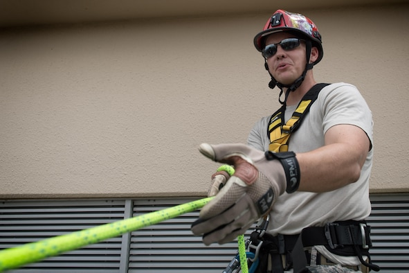Tech. Sgt. Shawn Edgecomb, 374th Civil Engineering Squadron assistant chief of fire prevention, briefs participants prior to rappelling down a building, August 7, 2017, at Yokota Air Base, Japan. Firefighters participate in this type of training to maintain the necessary skills to respond to fire emergencies. (U.S. Air Force photo by Airman 1st Class Juan Torres)