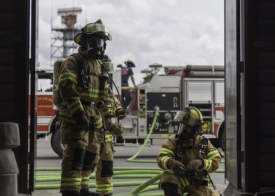 Firefighters assigned to the 374th Civil Engineering Squadron are on standby during structural live fire training, August 7, 2017, at Yokota Air Base, Japan. Firefighters participate in this type of training to maintain the necessary skills to respond to fire emergencies. (U.S. Air Force photo by Airman 1st Class Juan Torres)