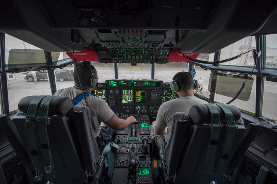 Crew chiefs from the 374th Aircraft Maintenance Squadron perform post-flight inspections at Yokota Air Base, Japan, Aug. 10, 2017. This is the 374th Airlift Wing's fourth new C-130J as the base transitions from the H model. The new C-130J is 81% quieter during takeoff, 14% faster, can travel 1,287 km further, and can carry 4,090 kg more than its predecessor, the C-130H Hercules. (U.S. Air Force photo by Yasuo Osakabe)