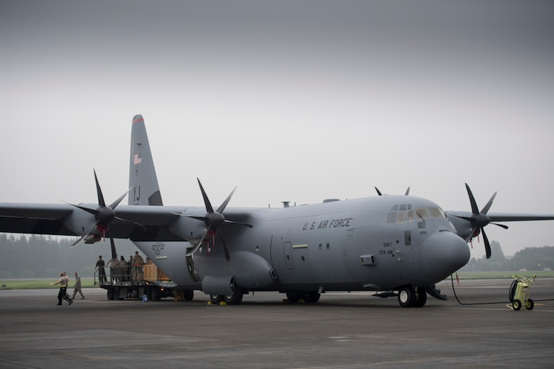alt=Crew members from the 36th Airlift Squadron unload pallets