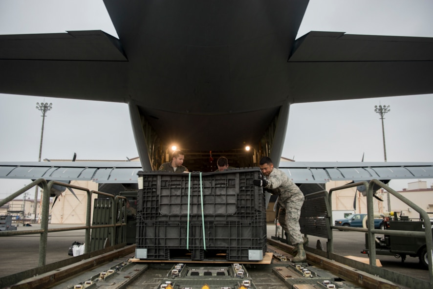 Airman from the 374th Operations Group unload cargo from a C-130J Super Hercules, Aug. 10, 2017 at Yokota Air Base, Japan. Yokota serves as the primary Western Pacific airlift hub for U.S. Air Force peacetime and contingency operations. Missions included tactical air land, airdrop, aeromedical evacuation, special operations and distinguished visitor airlift. (U.S. Air Force photo by Airman 1st Class Donald Hudson)