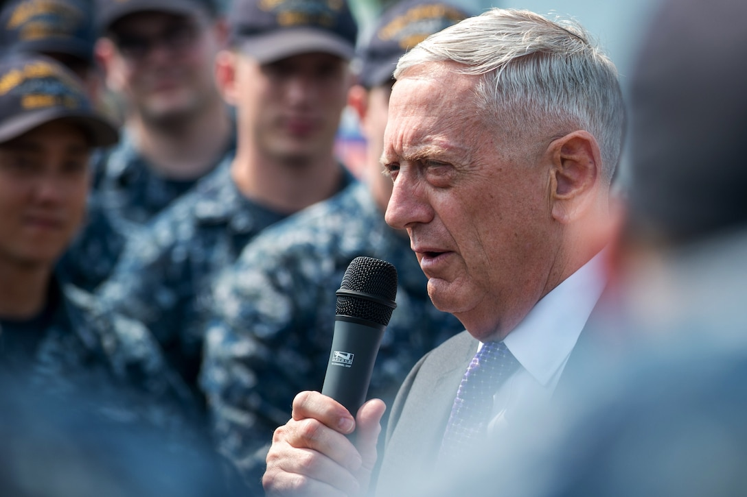 Defense Secretary Jim Mattis talks to large group of sailors.