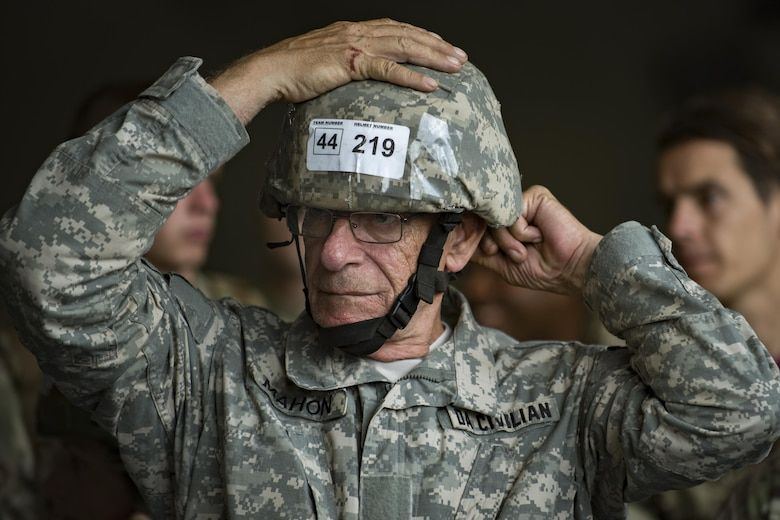 John Mahon, U.S. Army Soldier Systems Center jumper, fastens his helmet during Leapfest, Aug. 5, 2017, in West Kingstown, R.I. The Rhode Island National guard hosted the 34th annual event, which is the largest international static line jump competi-tion in the world. Team Moody's Airmen represent-ed the only U.S. sister-service team and earned second place among 70 participating teams. (U.S. Air Force photo by Airman 1st Class Daniel Snid-er)