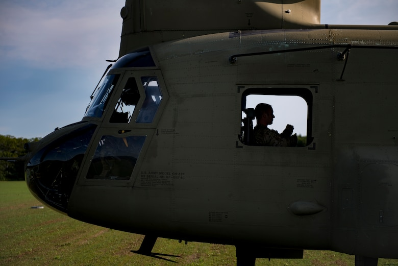 A U.S. Army Soldier awaits takeoff in a U.S. Army CH-47 Chinook during Leapfest, Aug. 6, 2017, in West Kingstown, R.I. The Rhode Island National guard hosted the 34th annual event, which is the largest international static line jump competition in the world. Team Moody's Airmen represented the only U.S. sister-service team and earned second place among 70 participating teams. (U.S. Air Force photo by Airman 1st Class Daniel Snider)