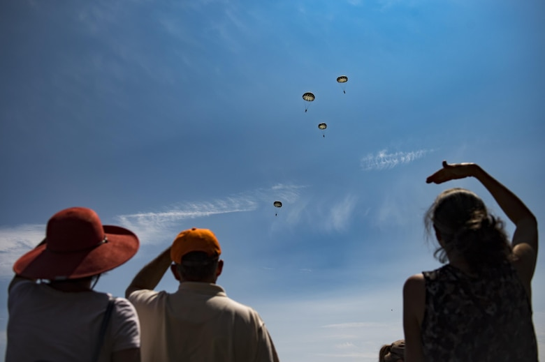 Spectators watch as paratroopers glide during Leapfest, Aug. 6, 2017, in West Kingstown, R.I. The Rhode Island National guard hosted the 34th annual event, which is the largest international stat-ic line jump competition in the world. Team Moody's Airmen represented the only U.S. sister-service team and earned second place among 70 participating teams. (U.S. Air Force photo by Air-man 1st Class Daniel Snider)