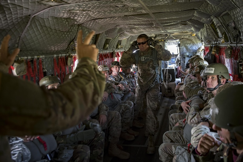 Crew members communicate in a U.S. Army CH-47 Chinook during Leapfest, Aug. 6, 2017, in West Kingstown, R.I. The Rhode Island National guard hosted the 34th annual event, which is the largest international static line jump competition in the world. Team Moody's Airmen represented the only U.S. sister-service team and earned second place among 70 participating teams. (U.S. Air Force photo by Airman 1st Class Daniel Snider)