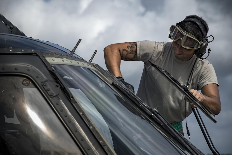 A maintainer from the 41st Helicopter Maintenance Unit washes a window on an HH-60G Pave Hawk, Aug. 8, 2017, at Tyndall Air Force Base, Fla.
