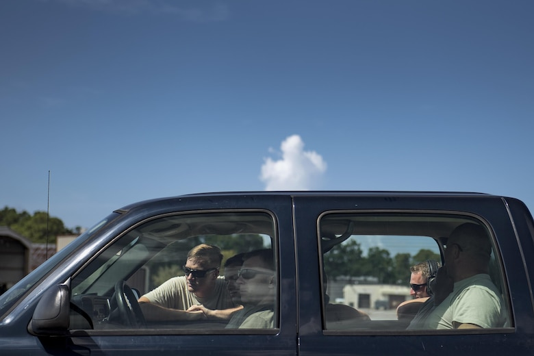 Maintainers from the 41st Helicopter Maintenance Unit catch a break from the heat in an air-conditioned truck, Aug. 8, 2017, at Tyndall Air Force Base, Fla.