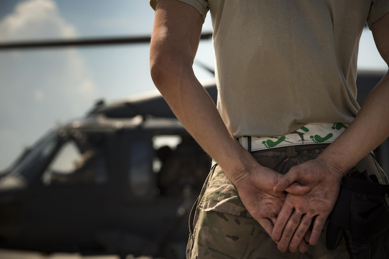 A maintainer from the 41st Helicopter Maintenance Unit stands by as an HH-60G Pave Hawk prepares for takeoff, Aug. 8, 2017, at Tyndall Air Force Base, Fla.