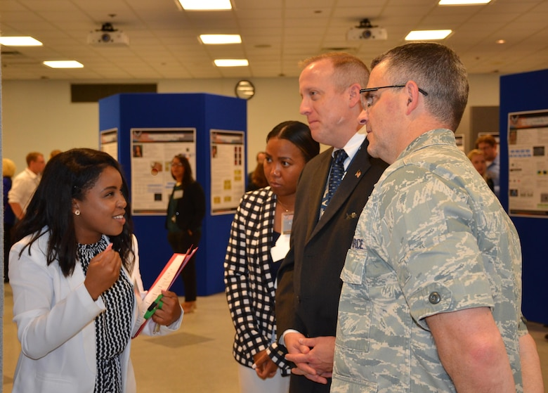 Summer students employed by the Materials and Manufacturing Directorate presented a culmination of their work at a poster session attended by leadership, mentors, and colleagues. (U.S. Air Force photo / Marisa Alia-Novobilski)