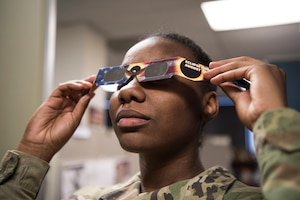 A member of the South Carolina National Guard tests her solar eclipse safety glasses Aug. 9, 2017, in Columbia, South Carolina. The glasses were distributed by the South Carolina National Guard Safety Office in preparation for the solar eclipse that will occur Aug. 21, 2017.