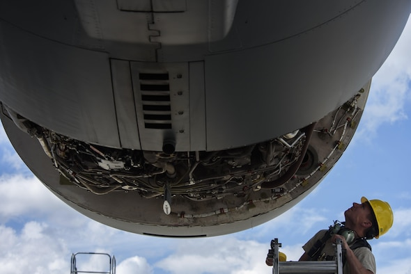 Staff Sgt. Amos Hard, 721st Aircraft Maintenance Squadron aerospace propulsion technician, assesses an engine on a C-17 Globemaster III at Spangdahlem Air Base, Germany, Aug. 9, 2017. The 726th Air Mobility Squadron worked with the 52nd Logistics Readiness Squadron vehicle operations, 52nd Civil Engineer Squadron Dirt Boyz, and 721st AMXS in support of fixing the engine which takes an average of 12 hours to complete. (U.S. Air Force photo by Staff Sgt. Jonathan Snyder)