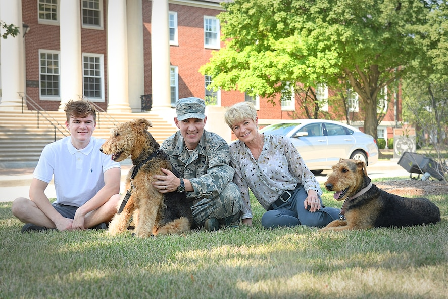 Pictured is the Howard family: Col. John Howard and wife, Dana, along with son, Kevin, and their dogs, Lucky and Cali. Their daughter, Emily, is not pictured.