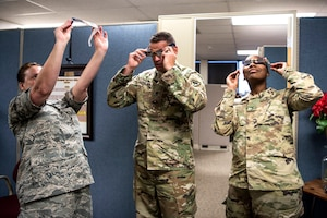 Members of the South Carolina National Guard test solar eclipse safety glasses.