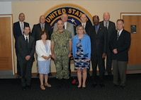 U.S. Navy Vice Adm. Charles Richard (front, center left), deputy commander of U.S. Strategic Command (USSTRATCOM), welcomes University of Nebraska Kearney (UNK) leaders to USSTRATCOM headquarters during their visit to Offutt Air Force Base, Neb., Aug. 9, 2017. While here, the UNK leaders received a briefing on USSTRATCOM's missions and priorities, toured an RC-135 Rivet Joint aircraft and visited the new command and control facility. UNK is one of 38 local and national universities that have joined the USSTRATCOM Deterrence and Assurance Academic Alliance. The alliance was created to develop a community of interest and leverage expertise to research the concepts and practice of deterrence and assurance, as well as encourage the development of deterrence professionals to meet the nation's need for future generations of leaders. One of nine Department of Defense unified combatant commands, USSTRATCOM has global strategic missions assigned through the Unified Command Plan that include strategic deterrence, space operations, cyberspace operations, joint electronic warfare, global strike, missile defense, intelligence, and analysis and targeting.