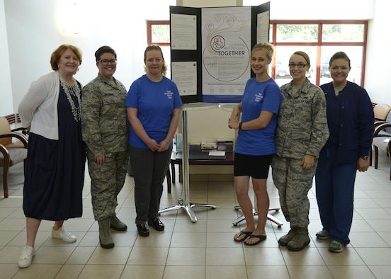 The 31st Medical Group labor and delivery team, Aviano Breastfeeding Support Group members, and Maj. Amber Barker, 59th Medical Wing perinatal clinical nurse specialist, pose for a group photo during a World Breastfeeding Week event at Aviano Air Base, Italy, Aug. 4, 2017. The event included  a question and answer session and healthy breastfeeding practices discussion. (U.S. Air Force photo by Tech. Sgt. Andrew Satran)