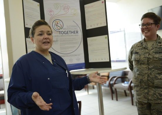 Maj. Amber Barker, 59th Medical Wing perinatal clinical nurse specialist, discusses healthy breastfeeding practices with Team Aviano members during a World Breastfeeding Week event at Aviano Air Base, Italy, Aug. 4, 2017. Barker also serves as the perinatal consultant to the U.S. Air Force Surgeon General. (U.S. Air Force photo by Tech. Sgt. Andrew Satran)