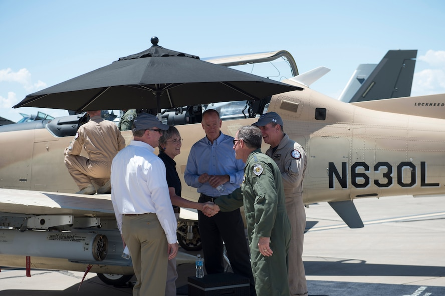 Secretary of the Air Force Heather Wilson meets with members from the Light Attack Experiment at Holloman Air Force Base, N.M., Aug. 9, 2017. Wilson had an immersion tour of Holloman and is here for a live-fly experiment with off-the-shelf aircraft. The Air Force is pursuing a Light Attack Capabilities Experimentation Campaign, which has grown out of our Close Air Support Experimentation Campaign. The Campaign is being led by the Air Force Strategic Development Planning and Experimentation Office under Air Force Materiel Command. (U.S. Air Force Airman 1st Class Alexis Docherty)