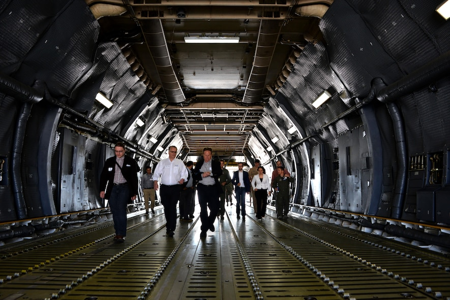 Professionals from across industry, academia and government tour a C-5M Super Galaxy during a base visit as part of the Phoenix Collider event at Travis Air Force Base, Calif., Aug. 1, 2017. Phoenix Spark is a program modeled to bridge the challenges of rapid innovation at the unit-level while navigating the administrative hurdles of compliance that often impede the velocity of change.  (U.S. Air Force photo/Staff Sgt. Charles Rivezzo)