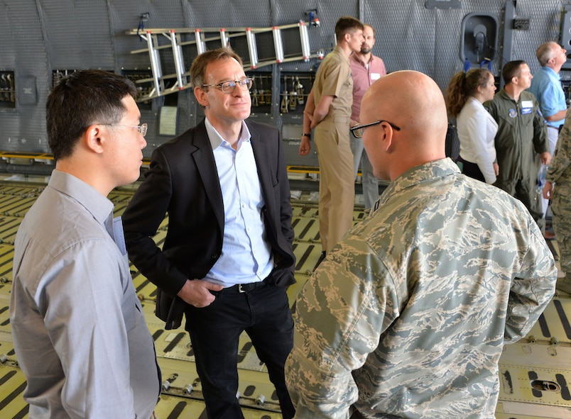 Capt. Garrett Custons (right), 60th Comptroller Squadron, talks with industry professionals during a tour of a C-5M Super Galaxy as part of a Phoenix Collider event at Travis Air Force Base, Calif., Aug. 1, 2017. Government and industry collaborations like Phoenix Collider are one of several avenues Phoenix Spark is pursuing to expand its footprint and develop solutions to enhance the lethality and efficiency of today's warfighter. (U.S. Air Force photo/Staff Sgt. Charles Rivezzo)