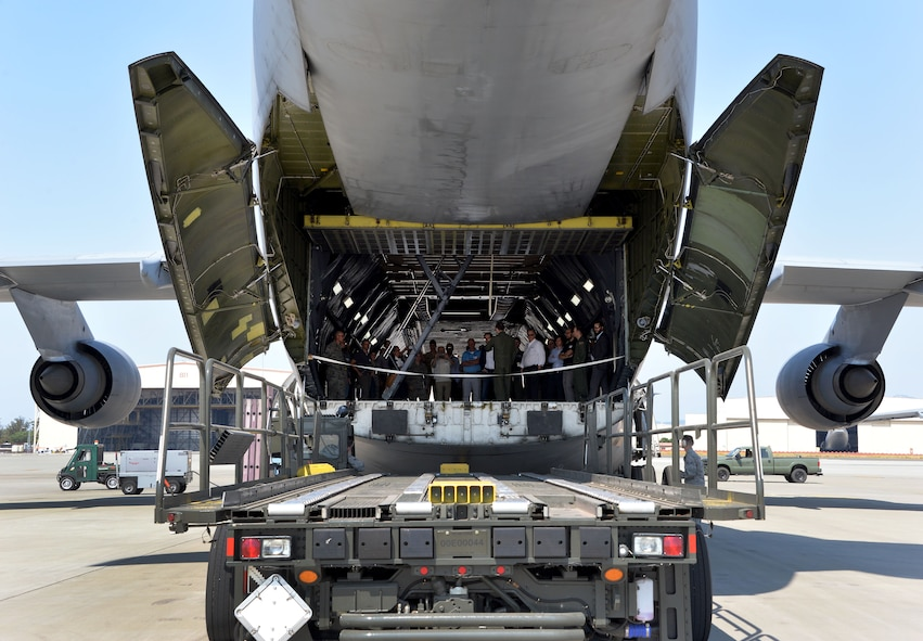 Professionals from across industry, academia and government tour a C-5M Super Galaxy during a base visit as part of a Phoenix Collider event at Travis Air Force Base, Calif., Aug. 1, 2017. Government and industry collaborations like Phoenix Collider are one of several avenues Phoenix Spark is pursuing to expand its footprint and develop solutions to enhance the lethality and efficiency of today's warfighter. (U.S. Air Force photo/Staff Sgt. Charles Rivezzo)