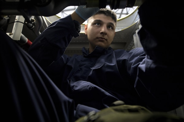 U.S. Air Force Senior Airman Edgar Gutierrez, 86th Maintenance Squadron fuel systems journeyman, repairs components inside the dry bay of a fuel tank for a C-130J Super Hercules on Ramstein Air Base, Germany, Aug. 8, 2017. C-130's are required to undergo a full inspection of their four main fuel tanks every 12 years. (U.S. Air Force photo by Senior Airman Tryphena Mayhugh)