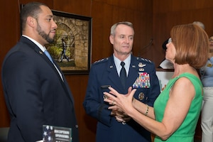 Lt. Gen. Darryl Roberson, commander of Air Education and Training Command, speaks with Tommy Calvert (left), Bexar County commissioner, and Diane Rath, AACOG executive director, prior to the presentation of the Altus Trophy at the San Antonio Chamber of Commerce Aug. 8, 2017. The trophy is presented annually by the AltusChamber of Commerce, located in Altus, Oklahoma, to a community judged to have shown outstanding support to an AETC base. (Air Force photo by Senior Airman Krystal Wright)