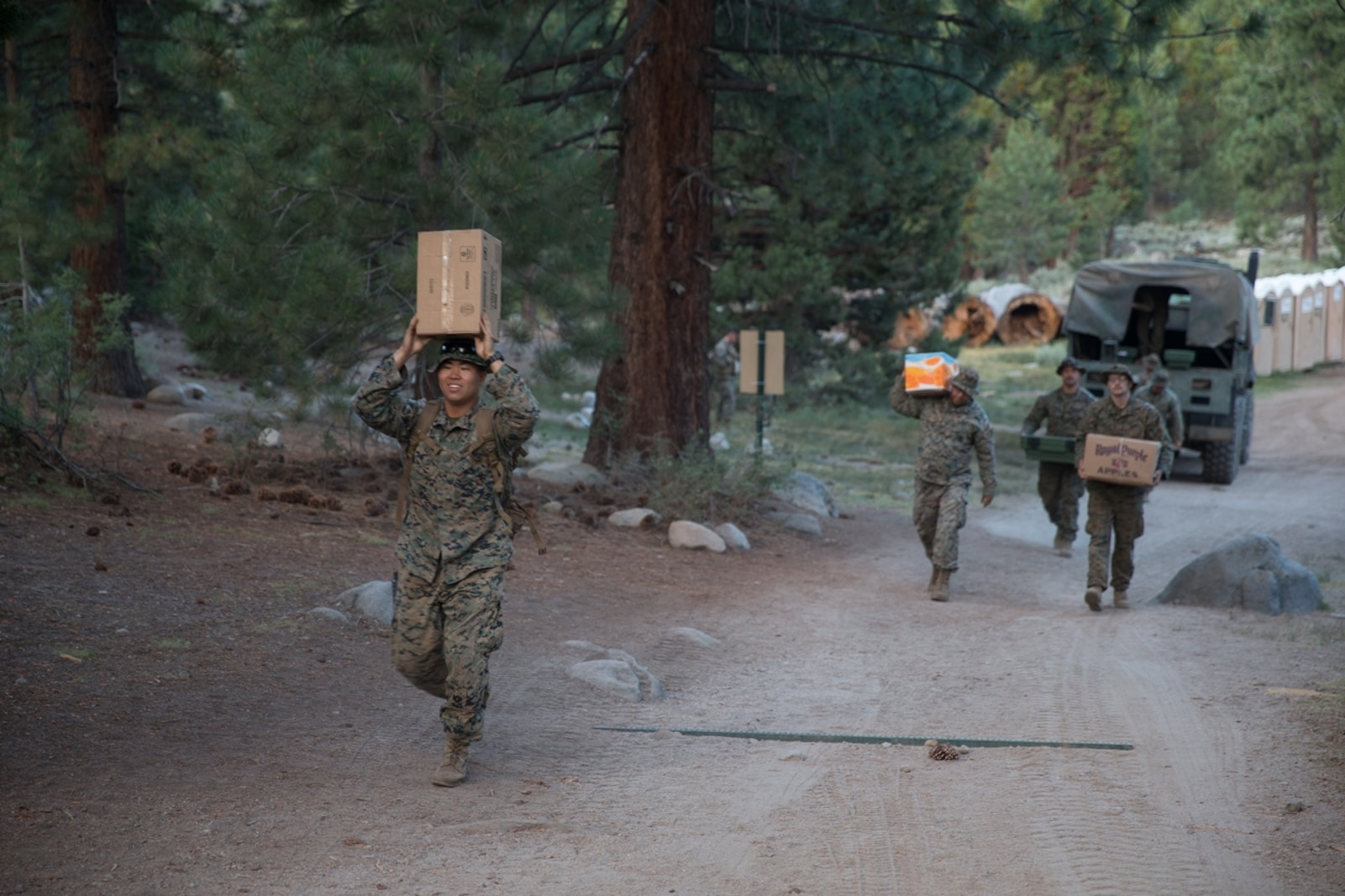 BRIDGEPORT, Calif., U.S. Marines with 2nd Battalion, 8th Marine Regiment, 2nd Marine Division carry boxes of field mess to the field mess hall during Mountain Training Exercise 4-17 at the Marine Corps Mountain Warfare Training Center Aug. 2, 2017. (U.S. Marine Corps photo by Lance Cpl. Timothy Shoemaker)