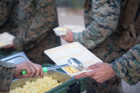 BRIDGEPORT, Calif. - U.S. Marines with 2nd Battalion, 8th Marine Regiment, 2nd Marine Division, II Marine Expeditionary Force serve chow during Mountain Training Exercise 4-17 at the Marine Corps Mountain Warfare Training Center Aug. 2, 2017. (U.S. Marine Corps photo by Lance Cpl. Timothy Shoemaker)