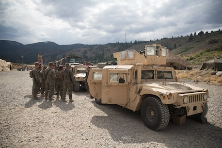 BRIDGEPORT, Calif. - U.S. Marines with Combat Logistics Battalion 5 (CLB-5), Combat Logistics Regiment 1, 1st Marine Logistics Group, receive a brief prior to a convoy during Mountain Training Exercise 4-17 at the Marine Corps Mountain Warfare Training Center Aug. 1, 2017. Information is passed down from the non-commissioned officers to the junior Marines to ensure they know where to go and what to do. (U.S. Marine Corps photo by Lance Cpl. Timothy Shoemaker)