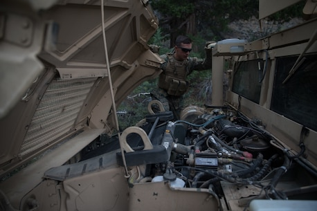 BRIDGEPORT, Calif. - U.S. Marine Cpl. David Moyer, a motor transportation operator with Combat Logistics Battalion 5 (CLB-5), Combat Logistics Regiment 1, 1st Marine Logistics Group, checks the engine of a High Mobility Multipurpose Wheeled Vehicle while on a convoy during Mountain Training Exercise 4-17 at the Marine Corps Mountain Warfare Training Center, Aug. 1, 2017. (U.S. Marine Corps photo by Lance Cpl. Timothy Shoemaker)