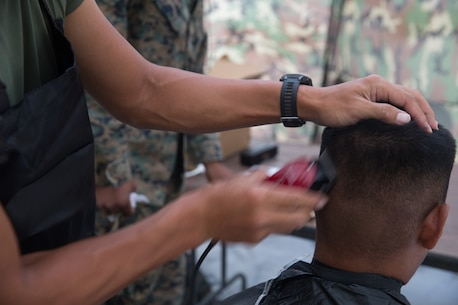 BRIDGEPORT, CALIF. - U.S. Navy LT Mark Won, the chaplain for Combat Logistics Battalion 5, Combat Logistics Regiment 1, 1st Marine Logistics Group, cuts hair during Mountain Training Exercise 4-17 on the Marine Corps Mountain Warfare Training Center, July 31, 2017. (U.S. Marine Corps photo by Lance Cpl. Timothy Shoemaker)
