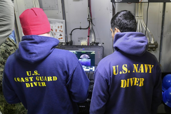 Coast Guard Petty Officer 2nd Class Adam Harris and Navy Petty Officer 2nd Class Matthew Villafuerte, divers deployed on the Coast Guard Cutter Healy, conduct remote operated vehicle operations in search of the wreckage from the fishing vessel Destination, in the Bering Sea, near St. George, Alaska, July 24, 2017. The Destination and its six crew members were lost February 11, 2017. U.S. Coast Guard photo by Petty Officer 2nd Class Meredith Manning