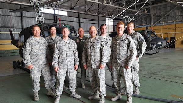 A group photo of 571st Mobility Support Advisory Squadron air advisors taken at the Belize Defense Force Air Wing. (Courtesy Photo)