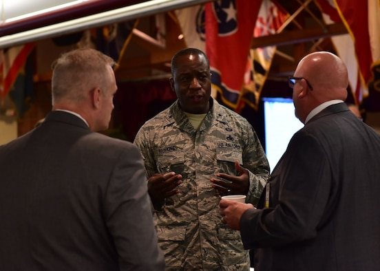 U.S. Air Force Brig. Gen. Stacey Hawkins, Air Mobility Command Logistics Engineering and Force Protection director, speaks with two industry partners during AMC's Industry Day Aug, 9. 2017, at Joint Base Lewis-McChord, Wash. Industry Day provides a platform to network and strengthen relationships with business partners. (U.S. Air Force photo by Senior Airman Mercedes Taylor)
