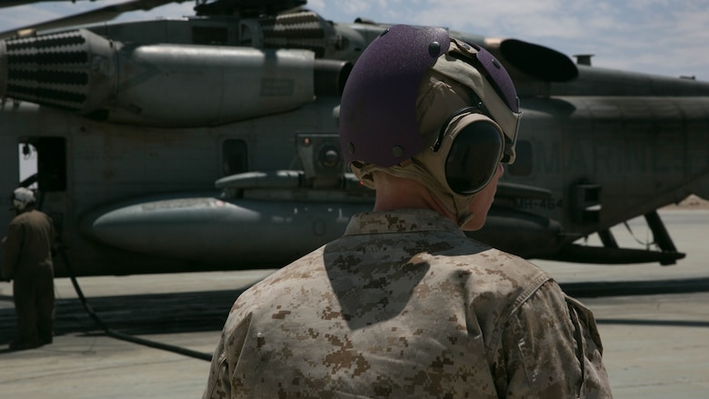 A Marine with Marine Wing Support Squadron 272, observes a hot refuel at the Strategic Expeditionary Landing Field at the Combat Center during Integrated Training Exercise 5-17, July 29, 2017. MWSS-272 is supporting the Aviation Combat Element of the ITX. The ACE conducts offensive, defensive, and all other air operations to support the MAGTF mission .