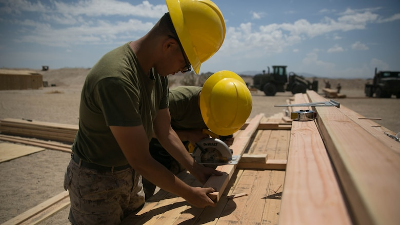 Marines with the engineer platoon for Marine Wing Support Squadron 272, cut wood for a Southwest Asia hut at the Combat Center during Integrated Training Exercise 5-17, July 29, 2017. MWSS-272 is supporting the Aviation Combat Element of the ITX. The ACE conducts offensive, defensive, and all other air operations to support the MAGTF mission .