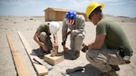 Marines with the engineer platoon for Marine Wing Support Squadron 272, construct a foundation for a Southwest Asia hut at the Combat Center during Integrated Training Exercise 5-17, July 29, 2017. MWSS-272 is supporting the Aviation Combat Element of the ITX. The ACE conducts offensive, defensive, and all other air operations to support the MAGTF mission .