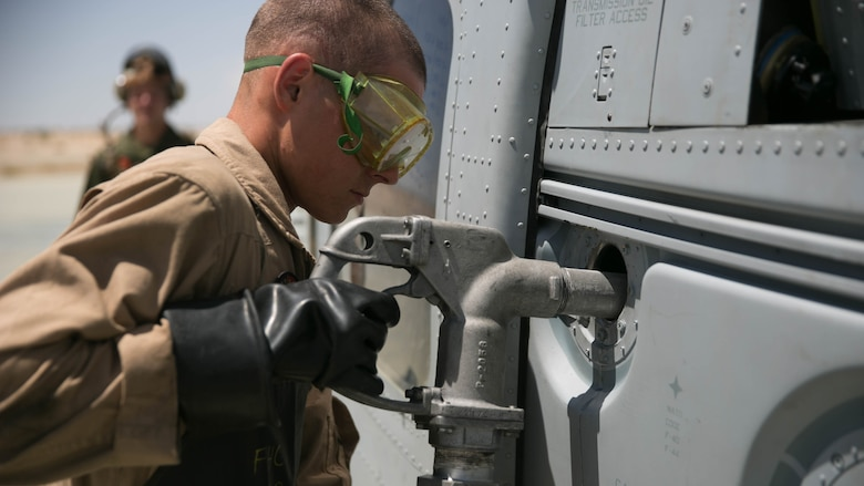 A Marine with Marine Wing Support Squadron 272, performs a cold refuel at the Strategic Expeditionary Landing Field at the Combat Center during Integrated Training Exercise 5-17, July 29, 2017. MWSS-272 is supporting the Aviation Combat Element of the ITX. The ACE conducts offensive, defensive, and all other air operations to support the MAGTF mission .