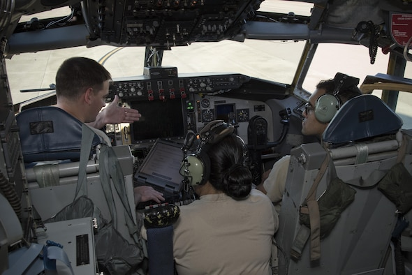 U.S. Air Force Airman 1st Class Bradley Cheeseman (left), an integrative flight control systems technician assigned to the 6th Aircraft Maintenance Squadron, poses a question to Tech. Sgt. Erica Northam (center), a communications, navigation, and mission systems instructor assigned to the 373rd Training Squadron, Detachment 2, and Senior Airman Steven Parras (right), an IFCS technician with the 6th AMXS, during a Block 45 course at MacDill Air Force Base, Fla., August 9, 2017. During this course, avionics technicians are taught how to use this new modern system on the KC-135 Stratotanker aircraft. (U.S. Air Force photo by Airman 1st Class Ashley Perdue)