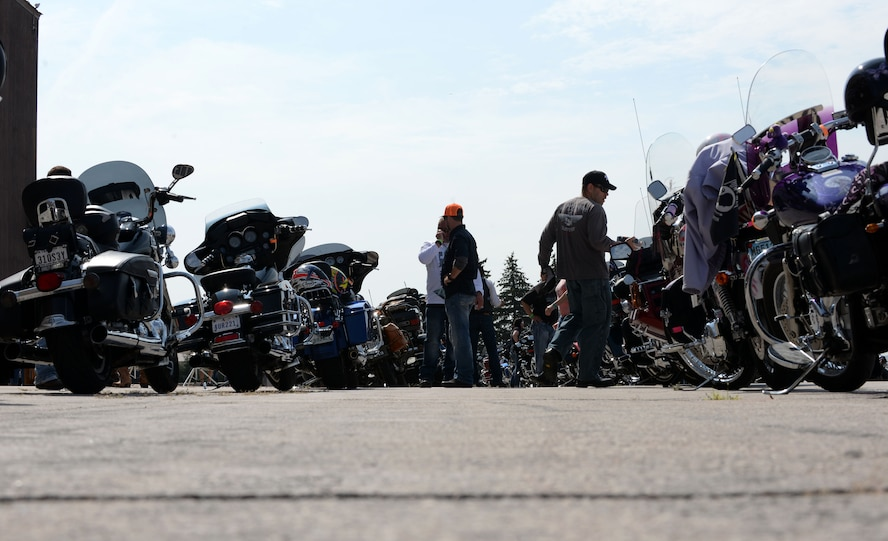 Bikers gather and talk about their motorcycles before riding to the Sturgis Veterans Appreciation Ceremony Aug. 8, 2017 on Ellsworth Air Force Base, S.D. This is the 17th Annual Dakota Thunder run and is hosted by the Green Knights Military Motorcycle Club. (U.S. Air Force photo by Airman 1st Class Thomas Karol)
