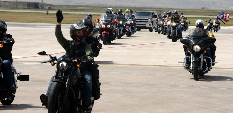 Motorcyclists begin the Dakota Thunder Run and exit the runway Aug 8, 2017 on Ellsworth Air Force Base, S.D. The ride started Ellsworth and ended at the Sturgis Veterans Appreciation Ceremony with stops in Nemo and Vanocher Canyon. (U.S. Air Force photo by Airman 1st Class Thomas Karol)