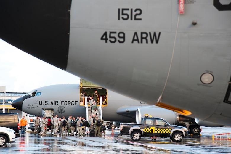 Passengers disembark from a 459th Air Refueling Wing KC-135R Stratotanker onto the Tallinn Airport, Estonia, flight line Aug. 5.