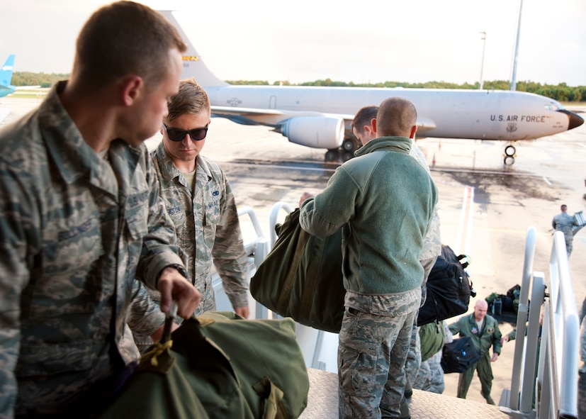 Passengers unload baggage from a 459th Air Refueling Wing KC-135R Stratotanker onto the Tallinn Airport, Estonia, flight line Aug. 5.