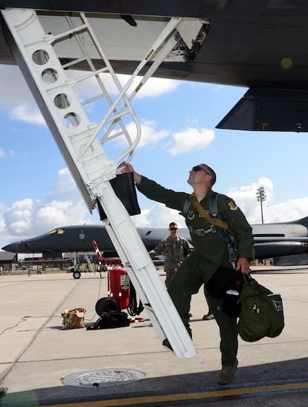 Col. Gentry W. Boswell, former 28th Bomb Wing commander, boards a B-1 bomber for the last time as commander of the 28th Bomb Wing at Ellsworth Air Force Base