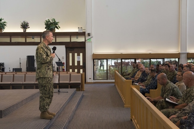 Rear Adm. Brian P. Fort addresses his staff as he assumes official command of Navy Region Hawaii and Naval Surface Group Middle Pacific at the Joint Base Pearl Harbor-Hickam Chapel Aug. 9, 2017. A change of command ceremony with Rear Adm. John Fuller was canceled in June when Fort was notified of an immediate assignment to Yokosuka, Japan to be an investigating officer of the USS Fitzgerald (DDG 60) collision. The Navy has not released results of the investigation.